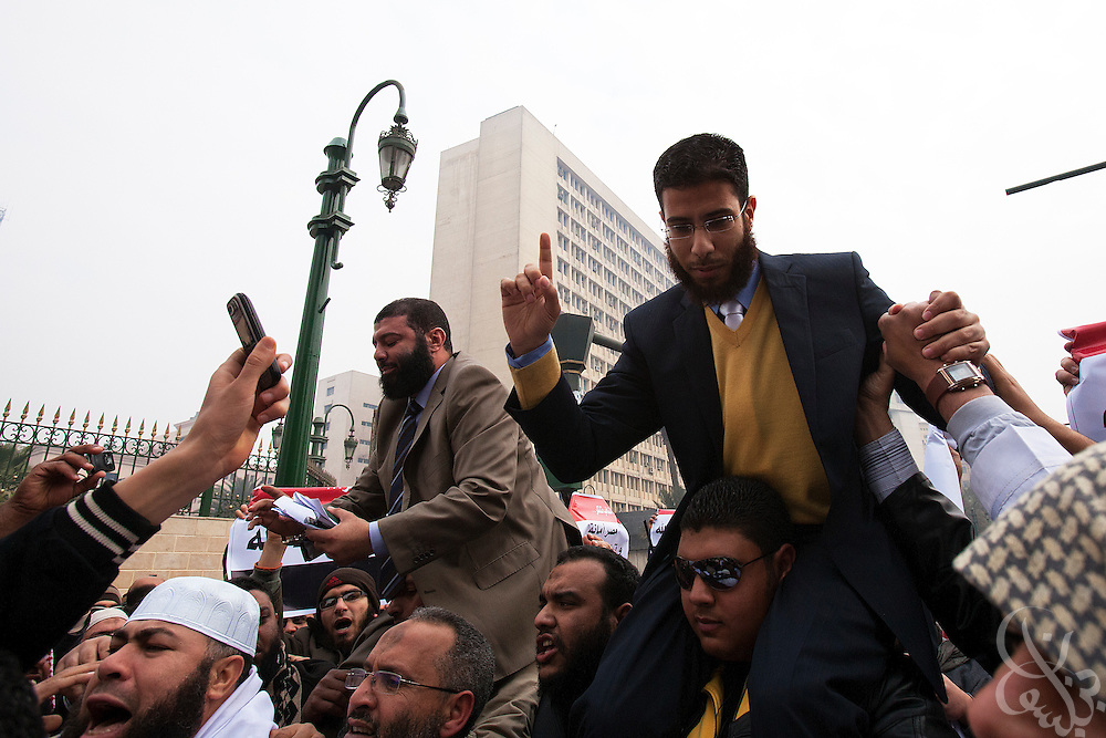 Egyptian Parliamentarians-elect Ahmed Khalil (l) and Nader Bakar are carried by members of their salafist Nour Party towards the parliament complex forthe historic first session of Egypt's newly elected Parliament Jan 23, 2012 in Cairo, Egypt.