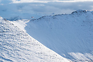 A coastguard helicopter flies over the Ben More ridge in northwest Scotland.
