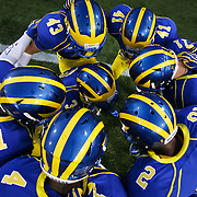 Delaware defensives backs Delaware Cornerback Joey Quigg #43, Delaware Cornerback Travis Hawkins #1, Delaware Cornerback Derrick Coleman #41, Delaware Cornerback  Jake Giusti #11, Delaware Cornerback Marcus Burley #2 huddle up together prior to a Week 1 NCAA football game against West Chester. ..#15 Delaware defeated West Chester 41-21 in their home opener at Delaware Stadium Thursday Aug. 30, 2012 in Newark Delaware...Delaware will return home Sept. 8, 2012 at 3:30pm for a showdown with interstate Rival Delaware State in the Route 1 Rivalry Bowl at Delaware Stadium.