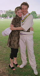 Actress EMILIA FOX and actor SAM WEST at a cricket match in London on 14th June 1999.MTE 3