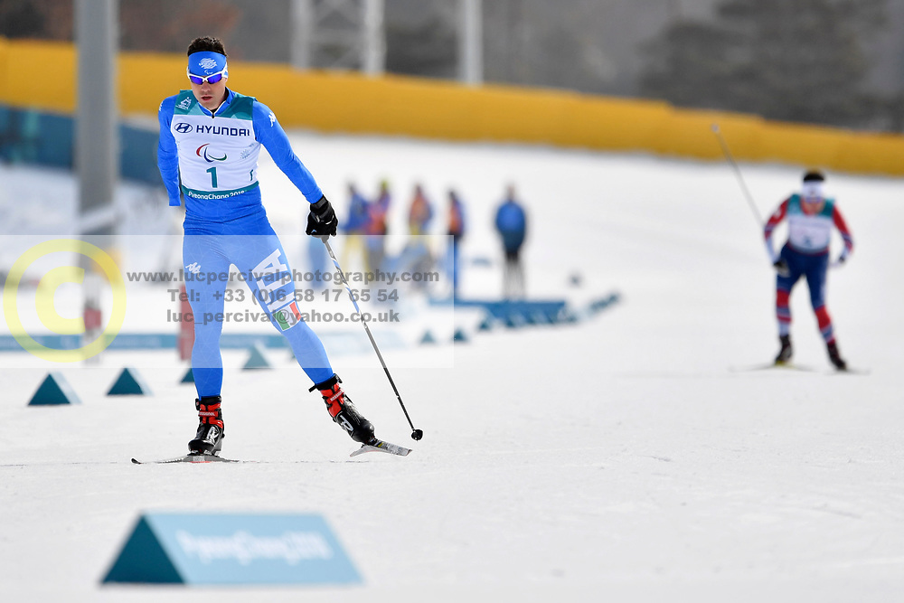 TONINELLI Cristian ITA LW8 competing in the ParaSkiDeFond, Para Nordic Skiing, 20km at  the PyeongChang2018 Winter Paralympic Games, South Korea.