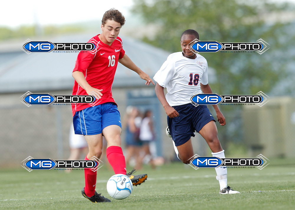May 10, 2014; Huntsville, AL, USA;  Vestavia Jake Dauphin (16) controls he ball from Oak Mountain Kennedy Davis (18) during the Championship game at John Hunt Soccer Complex. Mandatory Credit: Marvin Gentry