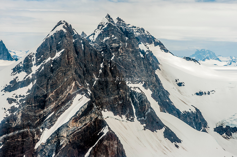 Aerial view of mountains rising above the Juneau Icefield.