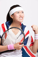 Female tennis player with British flag celebrating success against white background