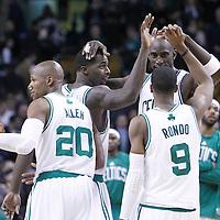 06 March 2012: Boston Celtics power forward Brandon Bass (30), Boston Celtics power forward Kevin Garnett (5), Boston Celtics shooting guard Ray Allen (20), and Boston Celtics point guard Rajon Rondo (9) celebrate during the Boston Celtics 97-92 (OT) victory over the Houston Rockets at the TD Garden, Boston, Massachusetts, USA.
