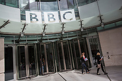 © licensed to London News Pictures. London, UK 15/04/2013. People walking outside BBC Broadcasting House in London on Monday, 15 April 2013. BBC says an edition of Panorama filmed secretly during a study trip to North Korea is due to be broadcast later as planned despite claims students may have been put in danger. Photo credit: Tolga Akmen/LNP