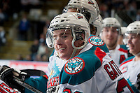 KELOWNA, CANADA - MARCH 23: Joe Gatenby #28 of the Kelowna Rockets is all smiles on the bench after scoring his first WHL goal against the Tri-City Americans on March 23, 2014 at Prospera Place in Kelowna, British Columbia, Canada.   (Photo by Marissa Baecker/Shoot the Breeze)  *** Local Caption *** Joe Gatenby;