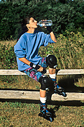 Woman drining water after rollerblading.