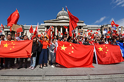 © Licensed to London News Pictures. 18/08/2019. LONDON, UK.  Members of the capital's Chinese community hold a rally in Trafalgar Square to support the people of Hong Kong and China.  They are calling for an end to police violence and a respect for law as protests in the former British colony enter their eleventh week.  Photo credit: Stephen Chung/LNP