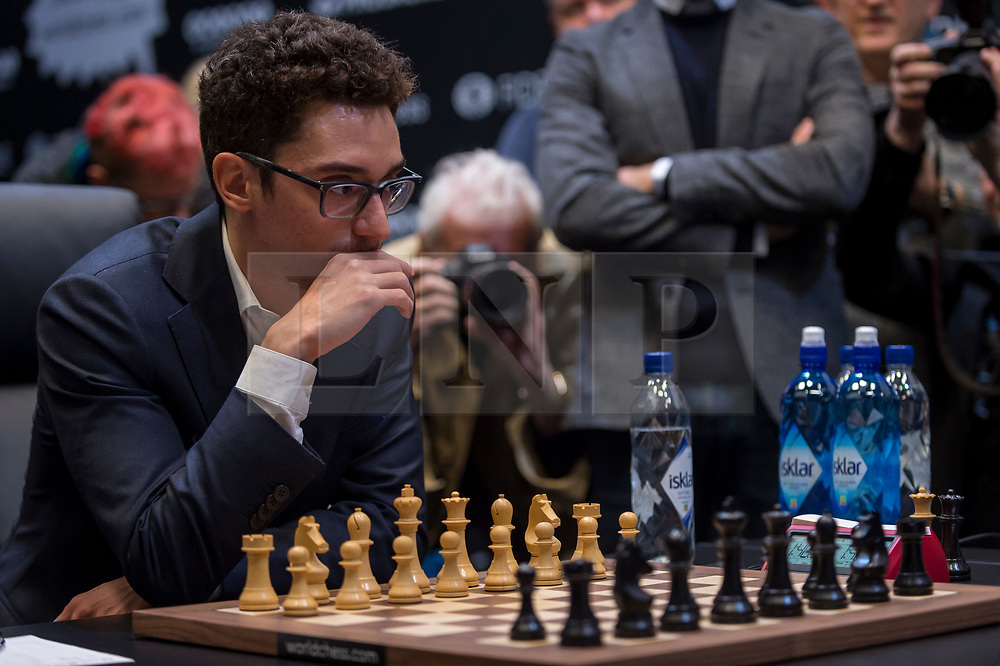 © Licensed to London News Pictures. 26/11/2018. LONDON, UK.  London, UK.  26 November 2018.  Magnus Carlsen (not pictured) of Norway competes against Fabiano Caruana (pictured) of the United States in the 12th game of the World Chess Championship taking place at The College in Holborn.  The 12 game match is currently tied after 11 draws.  Photo credit: Stephen Chung/LNP