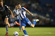 Brighton & Hove Albion's winger Jamie Murphy scores his second and Brighton's fourth to make it 4-0 during the EFL Cup match between Brighton and Hove Albion and Colchester United at the American Express Community Stadium, Brighton and Hove, England on 9 August 2016.