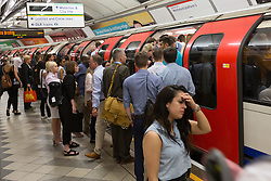 © Licensed to London News Pictures. 19/07/2016. LONDON, UK.  Commuters travel to work on the central line tube during hot weather in London this morning. Today is forecast to be the hottest day of the year so far.  Photo credit: Vickie Flores/LNP