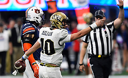 UCF Knights quarterback McKenzie Milton (10) motions a first down during the second half of the Chick-fil-A Peach Bowl NCAA college football game at the Mercedes-Benz Stadium in Atlanta, January 1, 2018. UCF won 34-27 to go undefeated for the season. (David Tulis via Abell Images for Chick-fil-A Peach Bowl)
