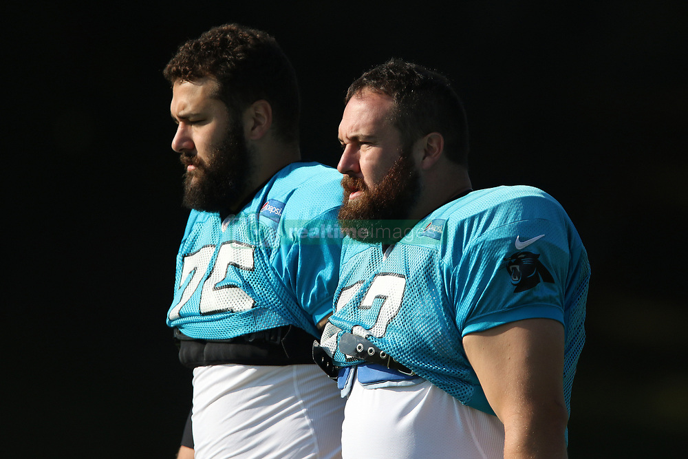 July 28, 2018 - Spartanburg, SC, U.S. - SPARTANBURG, SC - JULY 28: Brothers Matt Kalill (75) tackle   and Ryan Kalill (67) center Carolina Panthers walk to the field for the third day of the Carolina Panthers training camp practice at Wofford College July 28, 2018 in Spartanburg, S.C. (Photo by John Byrum/Icon Sportswire) (Credit Image: © John Byrum/Icon SMI via ZUMA Press)