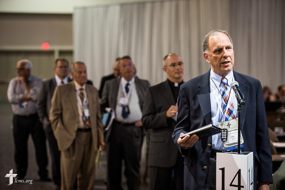 "The Rev. Dr. John Denninger, president of the LCMS Southeastern District, speaks during Floor Committee 12 ""Ecclesiastical Supervision and Dispute Resolution"" on Monday, July 11, 2016, at the 66th Regular Convention of The Lutheran Church–Missouri Synod, in Milwaukee. LCMS/Michael Schuermann"