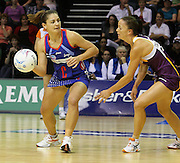 Temepara George gets a pass away in front of Katie Walker during round 4 of the ANZ Netball Championship - Queensland Firebirds v Northern Mystics. Played at Brisbane Convention Centre. Firebirds (46) defeated the Mystics (40).  Photo: Warren Keir (SMP/Photosport).<br /> <br /> Use information: This image is intended for Editorial use only (e.g. news or commentary, print or electronic). Any commercial or promotional use requires additional clearance.