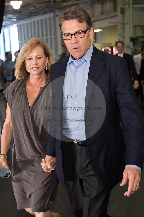 Former Texas Governor and GOP presidential hopeful Rick Perry with his wife Anita Perry before holding a town hall aboard the USS Yorktown June 8, 2015 in Mount Pleasant, South Carolina.