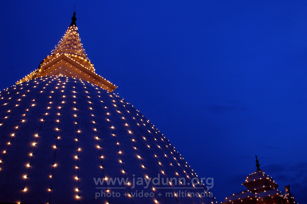Sri Lanka, Colombo, 2006. Night lights at the Kelaniya Vihara Buddhist temple, the largest in Colombo. The classic stupa shape echoes that of a bodhi leaf.