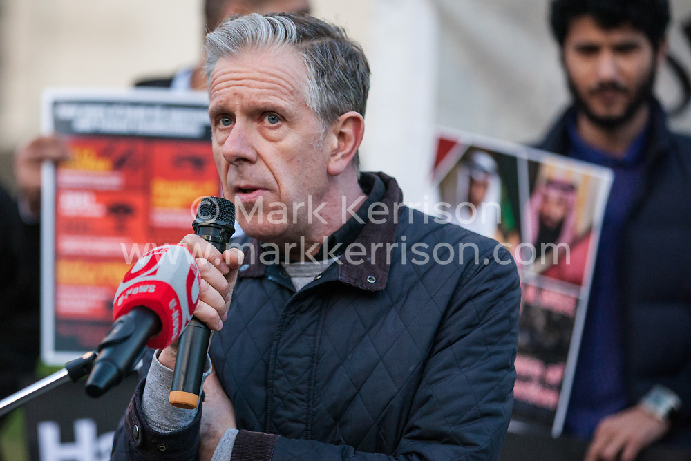 London, UK. 26th March, 2019. Chris Nineham of Stop The War Coalition addresses human rights campaigners from several different groups including Stop The War Coalition and Campaign Against the Arms Trade protesting opposite Downing Street against British arms sales to Saudi Arabia used to wage a 4-year war in Yemen. According to charity Save The Children, an estimated 85,000 children under the age of five may have died from acute malnutrition since the war began in 2015 and 14 million Yemenis are believed to face the risk of famine; according to the United Nations, millions of citizens have been displaced, over 56,000 Yemenis have been killed and the country is facing the 'world's worst humanitarian crisis'.