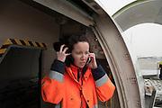 Inspection of the freight of a cargo airplane. At Roissy, Nesrine, 34, works as a technical inspector  for the DGCA (Directorate General of Civil Aviation) - she is the only female technical controller at the airport of Roissy-en-France. She can stop a Boeing taking off and make the 300 passengers leave the airplane. Nesrine Chkioua is the only woman controller at Roissy Airport and one of three women doing this job in France.<br /> <br /> <br /> À Roissy, Nesrine, 34 ans, exerce le métier de contrôleur technique (CTE) pour la DGAC (Direction générale de l'aviation civile) - elle est la seule femme contrôleur technique à l'aéroport de Roissy-en-France.  Elle peut immobiliser un Boeing, retarder le décollage et même faire débarquer les 300 passagers d'un long-courrier. Nesrine Chkioua est la seule contrôleur femme à Roissy aéroport et est une des trois femmes à exercer ce métier en France.