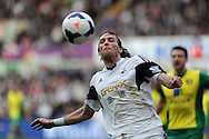 Swansea city's Michu in action.Barclays premier league match , Swansea city v Norwich city at the Liberty stadium in Swansea, South Wales on Saturday 29th March 2014.<br /> pic by Andrew Orchard,  Andrew Orchard sports photography.