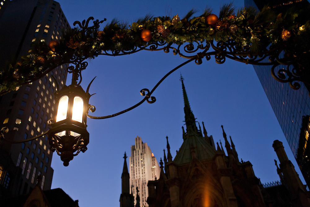 The Lady Chapel of St. Patrick's Cathedral framed by the entrance to the courtyard of the New York Palace Hotel, the entrance with holiday decorations.