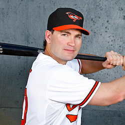 February 26, 2011; Sarasota, FL, USA; Baltimore Orioles left fielder Luke Scott (30) poses during photo day at Ed Smith Stadium.  Mandatory Credit: Derick E. Hingle