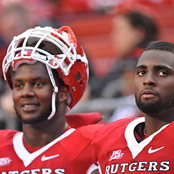 Sep 12, 2009; Piscataway, NJ, USA; Rutgers offensive lineman Anthony Davis (75) and offensive lineman Kevin Haslam (78) watch the game from the bench during the second half of Rutgers' 45-7 victory over Howard in NCAA college football at Rutgers Stadium