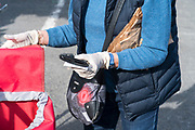 person wearing surgical gloves while shopping during the Covid 19 crisis and lockdown France Limoux April 2020