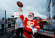 Kansas City Corporate Event and Marketing Photographer - A Chiefs fan enjoys a game of quarterback toss at the Built Ford Tough Toughest Tailgate at Arrowhead Stadium on Sunday, December 25, 2016, in Kansas City, MO. Photo by Colin E. Braley for Ford