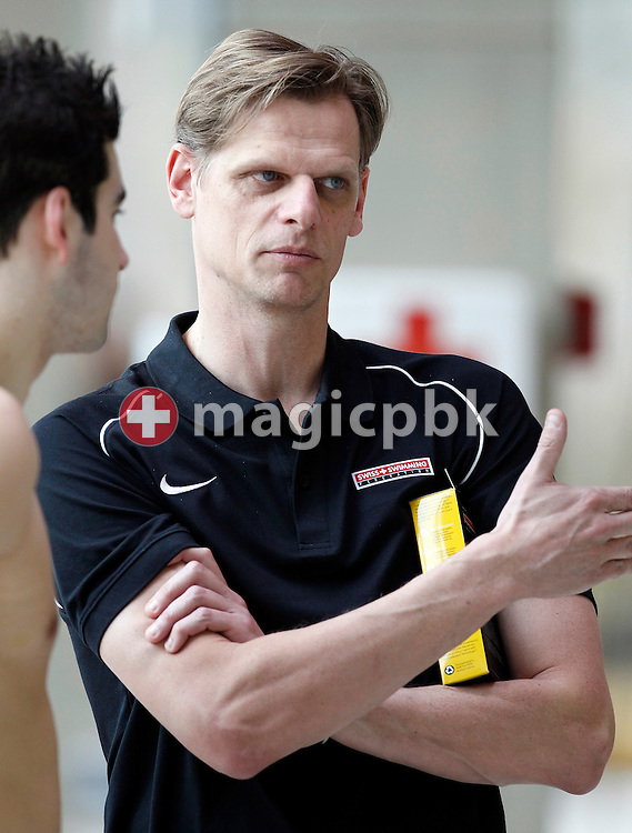 Swiss Swimming's national high performance director Steffen LIESS (R) talks to a swimmer at the Swiss Swimming Championships in Geneva, Switzerland, Thursday, March 11, 2010. (Photo by Patrick B. Kraemer / MAGICPBK)