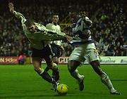 29/11/2003 - Photo  Peter Spurrier.2003/04 Nationwide Football Div 2 QPR V Sheffield Wed. Grant Holt [left] and Dan Shittu contest the ball.