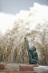 Stock photo of huge waves crashing into the seawall behind the 1900 Storm Memorial Statue by David W. Moore during Hurricane Ike in Galveston Texas
