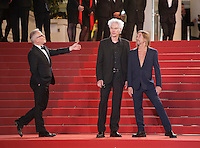Festival director Thierry Fremaux welcomes Director Jim Jarmusch and  Iggy Pop at the gala screening for the film Gimme Danger at the 69th Cannes Film Festival, Thursday 19th May 2016, Cannes, France. Photography: Doreen Kennedy