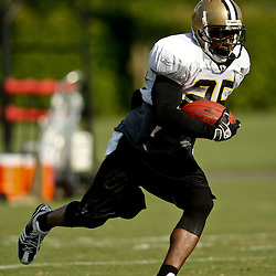August 1, 2010; Metairie, LA, USA; New Orleans Saints running back Reggie Bush (25) runs with the ball during a training camp practice at the New Orleans Saints practice facility. Mandatory Credit: Derick E. Hingle