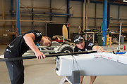 Peter Burling gets some tips on setting up his A Class from Glenn Ashby. Emirates Team New Zealand sailors prepare their A Class catamarans for the upcoming National championships  and World championships regattas being sailed at Takapuna in Auckland. 5/2/2014