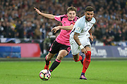Scotland Midfielder James Forrest battles with England Defender Kyle Walker during the FIFA World Cup Qualifier group stage match between England and Scotland at Wembley Stadium, London, England on 11 November 2016. Photo by Phil Duncan.