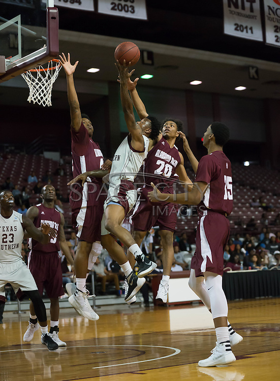 Chris Thomas of TSU goes up over Alabama A&M defenders. TSU defeats Alabama A&M 77-54 at the HP&E Arena in Houston, Texas. Photo By: Jerome Hicks/ Space City Images
