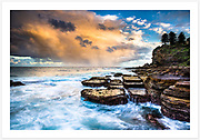 A colourful sunset sky viewed from the rock platforms at the southern end of Avalon Beach , northern beaches of Sydney. [Avalon, NSW, Australia]<br />