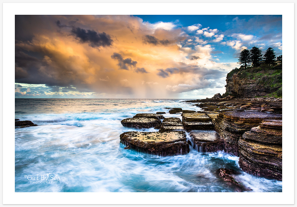 A colourful sunset sky viewed from the rock platforms at the southern end of Avalon Beach , northern beaches of Sydney. [Avalon, NSW, Australia]<br /> <br /> To order please email orders@girtbyseaphotography.com quoting the image number PB203869, and your preferred print size. You will receive a quick reply recommending print media options to best suit your chosen image, plus an obligation-free quotation. See the pricing page for current standard size prices.