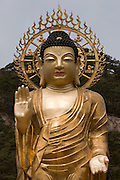 Songnisan National Park. Beopjusa Temple. The 33m high, 160 ton golden Buddha statue overlooks the wide-spread temple premises.