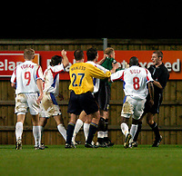 Photo: Richard Lane.<br />Oxford United v Carlisle United. Nationwide Division Three. 13/12/2003.<br />Referee, S Tanner loses control asthe Carlisle players push Oxford keeper, Andy Woodman after a challenge on Kevin Henderson, resulting in a penalty.