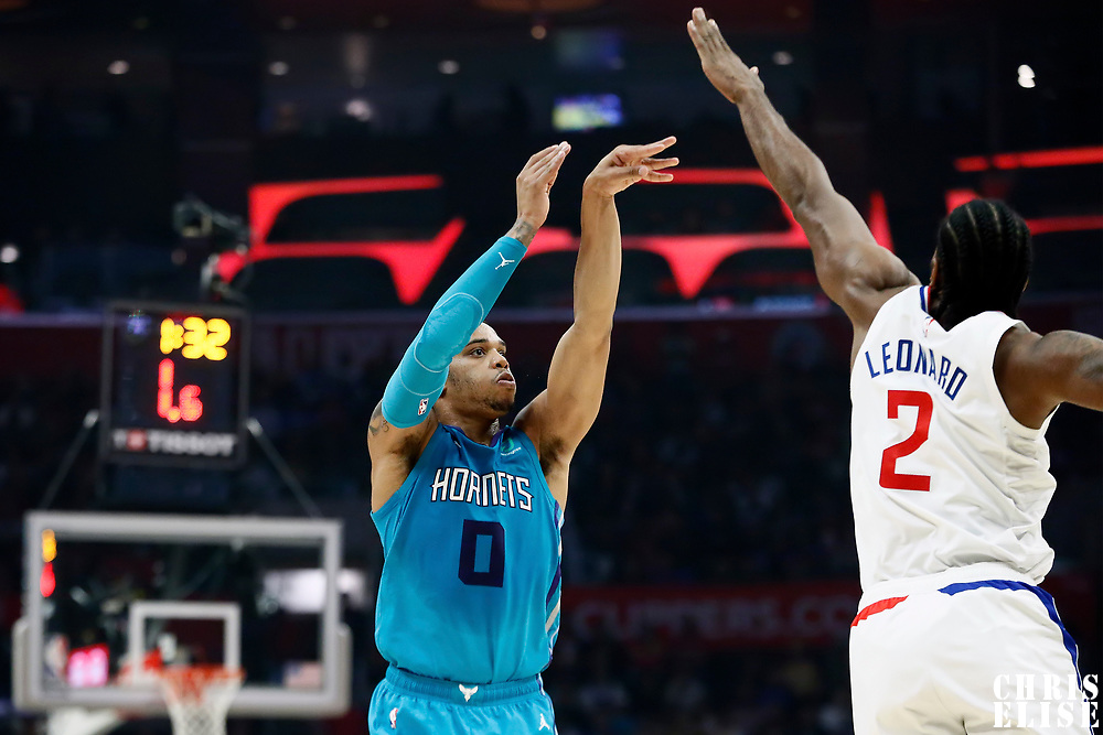 LOS ANGELES, CA - OCT 28: Miles Bridges (0) of the Charlotte Hornets shoots the ball against Kawhi Leonard (2) of the LA Clippers during a game on October 28, 2019 at the Staples Center, in Los Angeles, California.
