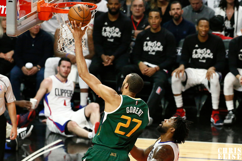 25 April 2017: Utah Jazz center Rudy Gobert (27) goes for the layup past LA Clippers center DeAndre Jordan (6) during the Utah Jazz 96-92 victory over the Los Angeles Clippers, during game 5 of the first round of the Western Conference playoffs, at the Staples Center, Los Angeles, California, USA.
