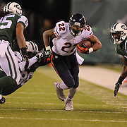 Matt Forte, Chicago Bears, is tackled by Muhammad Wilkerson, New York Jets, during the New York Jets Vs Chicago Bears, NFL regular season game at MetLife Stadium, East Rutherford, NJ, USA. 22nd September 2014. Photo Tim Clayton for the New York Times