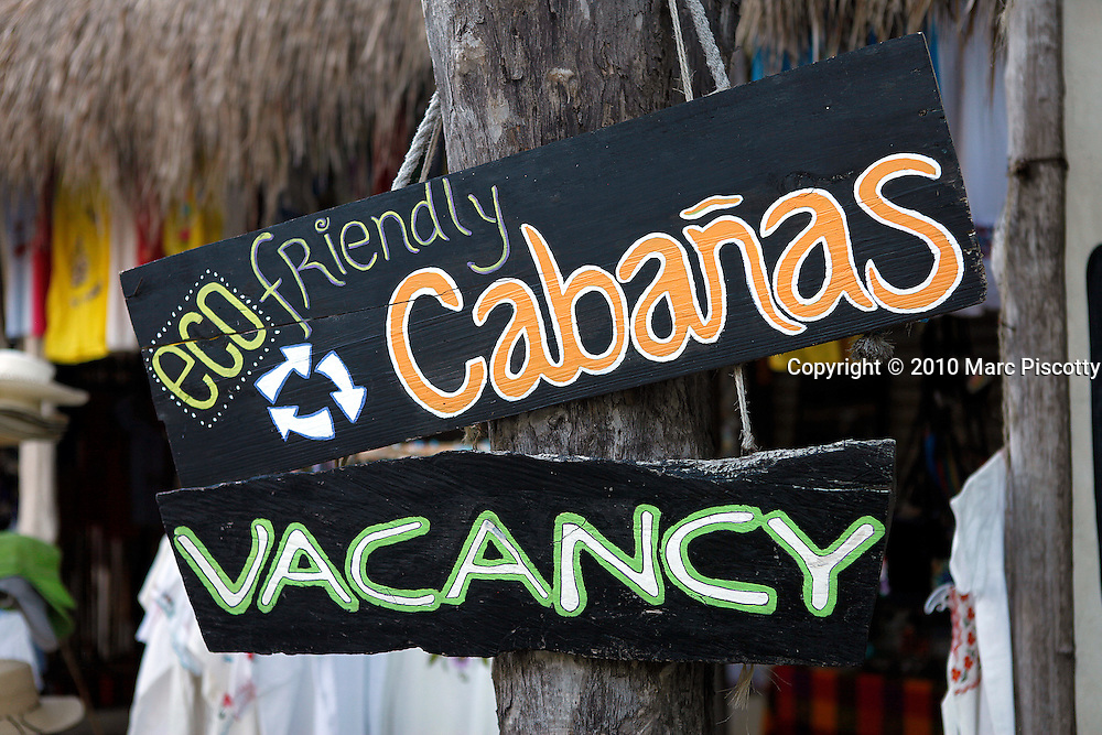 SHOT 12/4/10 4:09:26 PM - Signs advertising some of the many cabanas that have sprung up around Tulum, Mexico. Trip to Tulum Mexico with Margaret Ebeling. Tulum (Yucatec: Tulu'um) is the site of a Pre-Columbian Maya walled city serving as a major port for Cobá. One of the best-preserved coastal Maya sites, Tulum is today a popular site for tourists. The tourist destination is now divided into four main areas: the archaeological site, the pueblo (or town), the zona hotelera (or hotel zone) and the biosphere reserve of Sian Ka'an. Coba (Cobá in the Spanish language) is a large ruined city of the Pre-Columbian Maya civilization, located in the state of Quintana Roo, Mexico. (Photo by Marc Piscotty / © 2010)