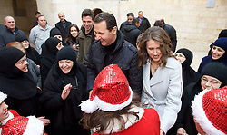 Syrian president Bashar Al Assad and his wife Asma visit the Sednaya convent, and meet with children and religious personalities on Christmas day, in Sednaya, near Damascus, Syria on December 25, 2016. Photo by Balkis Press/ABACAPRESS.COM