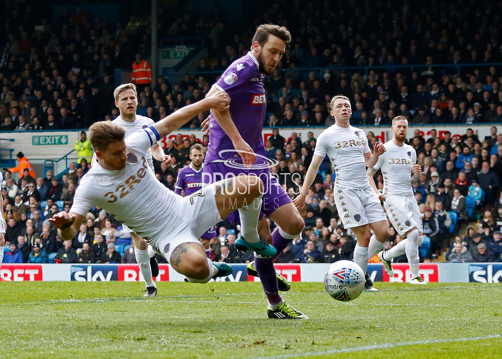 Leeds United defender Gaetano Berardi tries to avoid conceding a corner with Bolton Wanderers forward Adam Le Fondre in attendance during the EFL Sky Bet Championship match between Leeds United and Bolton Wanderers at Elland Road, Leeds, England on 30 March 2018. Picture by Paul Thompson.