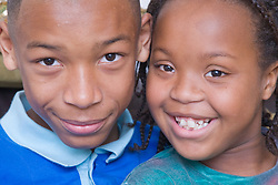 Portrait of a brother and sister smiling,