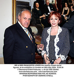 MR & MRS PANAGIOTIS LEMOS the wealthy Greek social figures, at an exhibition in London on 26th May 2004.PUM 39